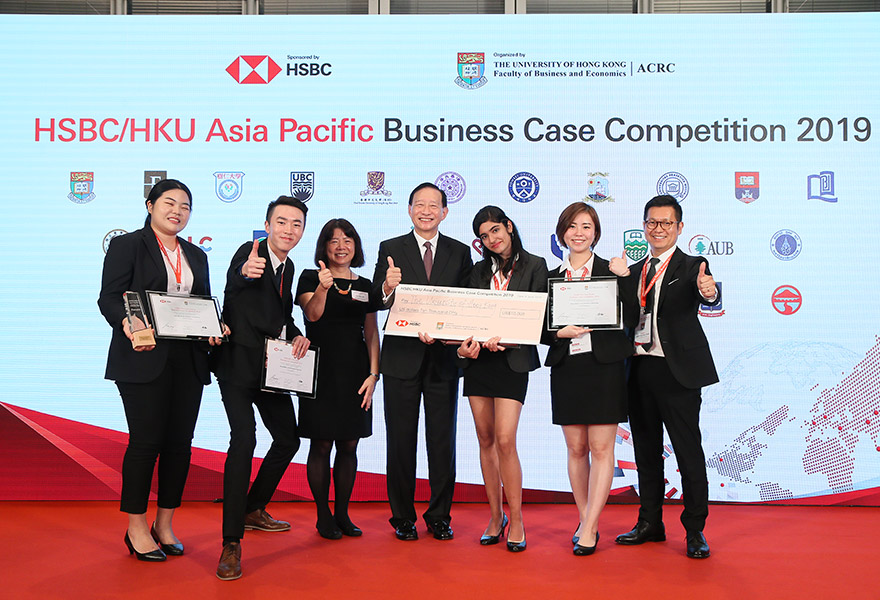 Peter Wong, Deputy Chairman and Chief Executive, The HongKong and Shanghai Banking Corporation Limited, with the winning team from Yonsei University